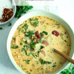 bowl and surrounding of zuppa toscana soup