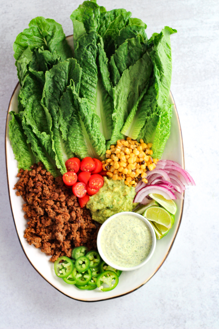 Taco salad with jalapeno ranch dressing on large platter