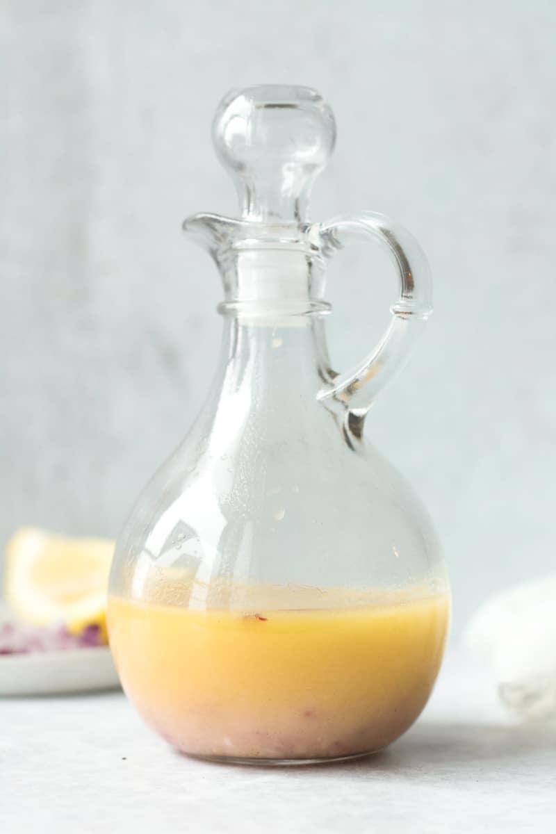 glass bottle of lemon garlic vinaigrette