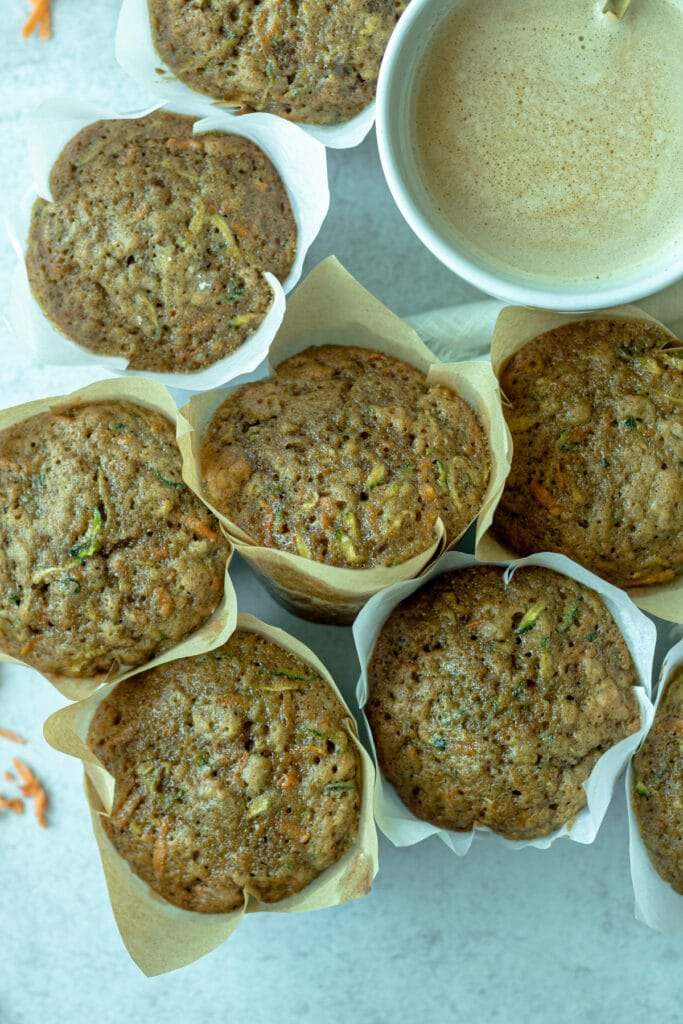 group of sweet potato zucchini muffins with coffee