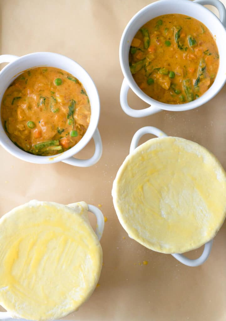 four mini pot pies ready for oven